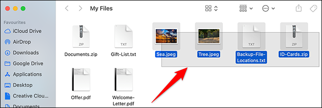 Drag with a mouse or trackpad to select multiple files in Finder.