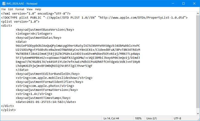 Un file AAE di Apple visualizzato nel Blocco note di Windows