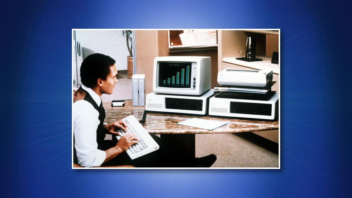 A man using an IBM PC 5150