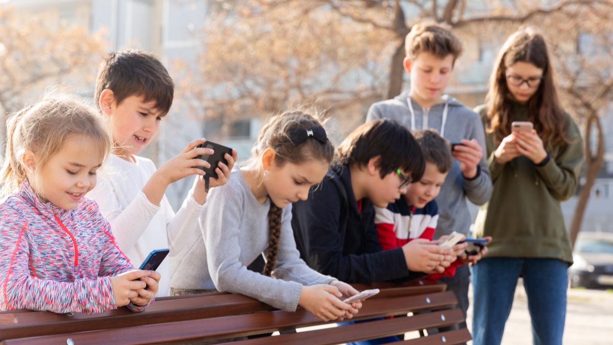 Kids using phones.