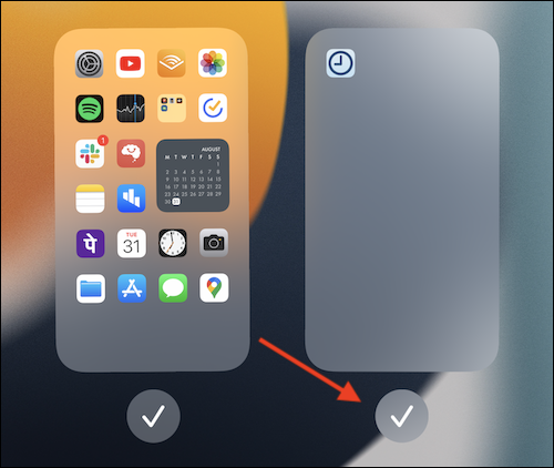 Tap the Checkmark button below the home screen page that you want to remove.