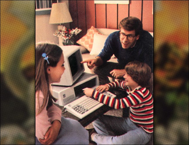 A family with an IBM PC as seen in a 1981 IBM promotional image.