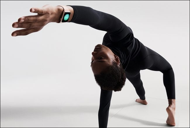 person wearing apple watch while doing yoga