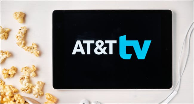 AT&T TV logo on a tablet next to spilled popcorn