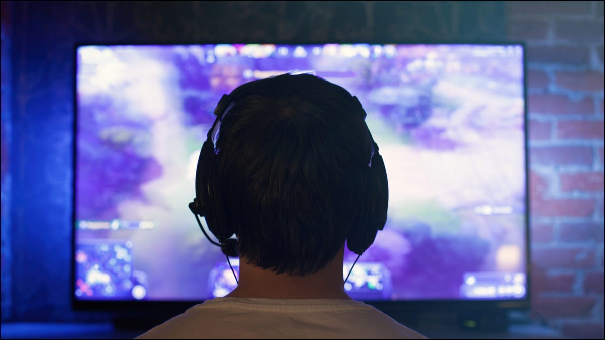 man playing games on TV