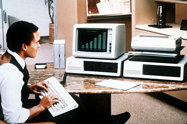 A man using an IBM PC in 1981.