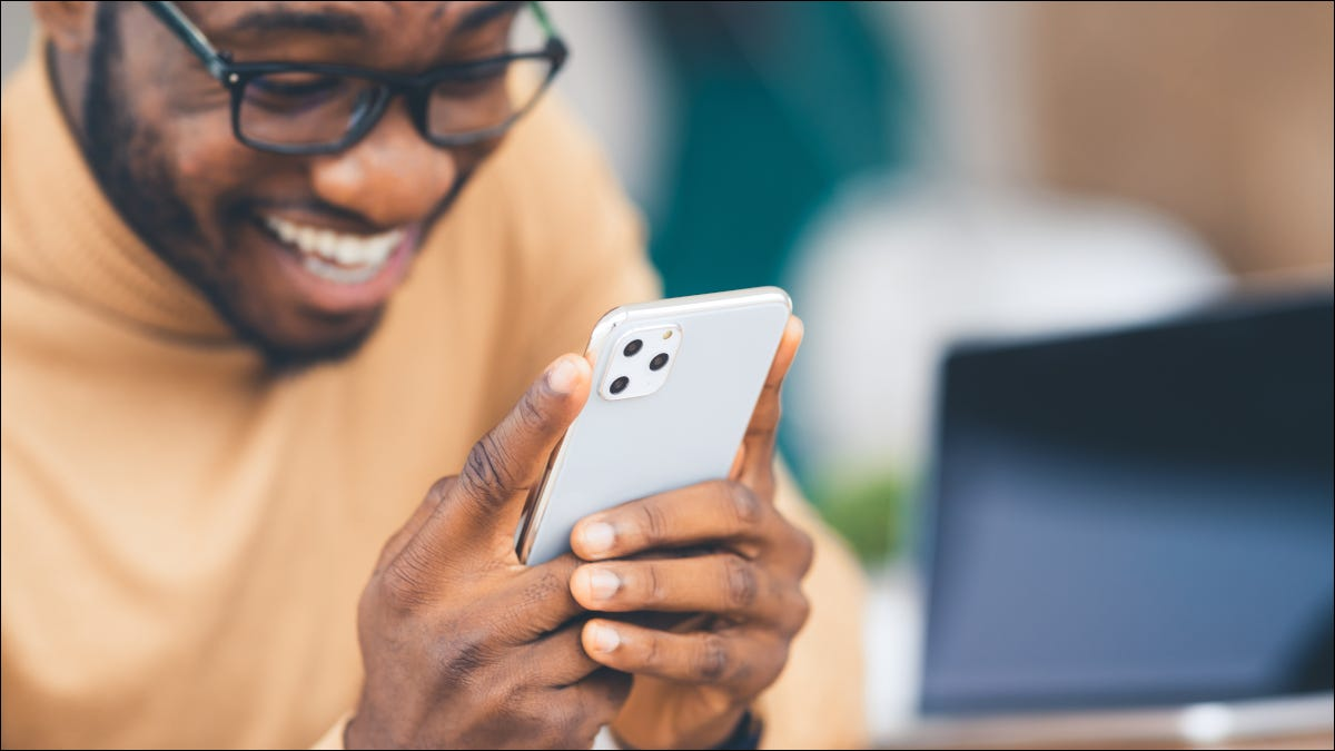 Man looking excitedly at new iPhone