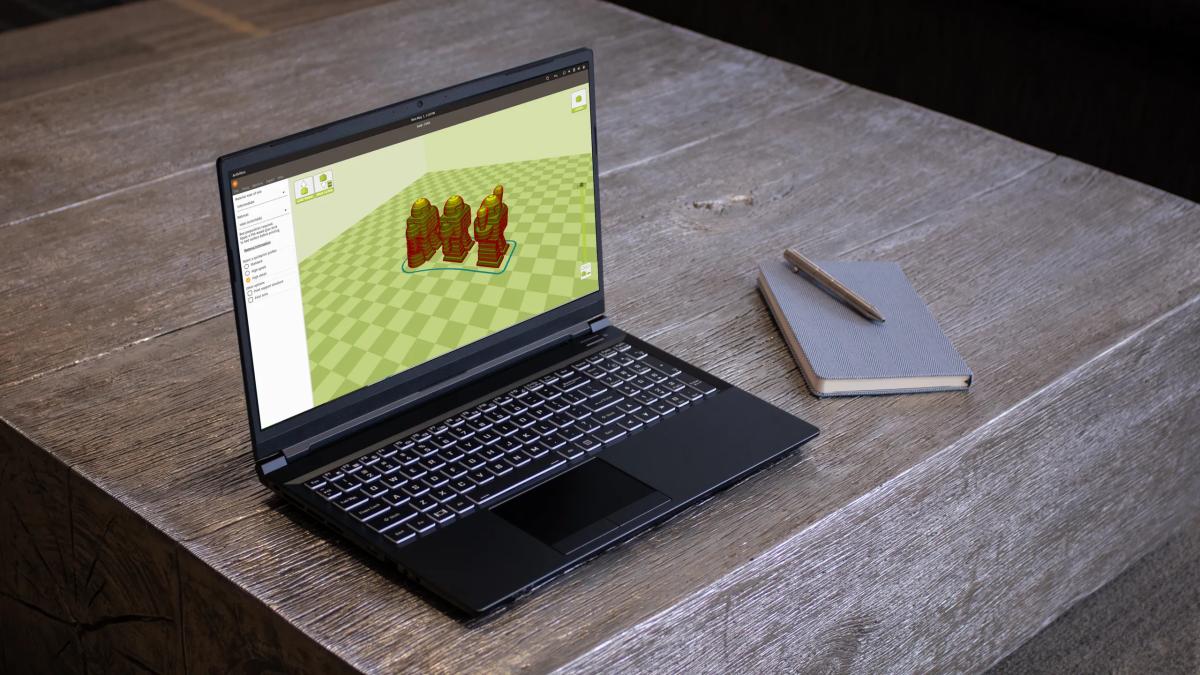 A System76 Oryx Pro Linux gaming laptop on a desk.