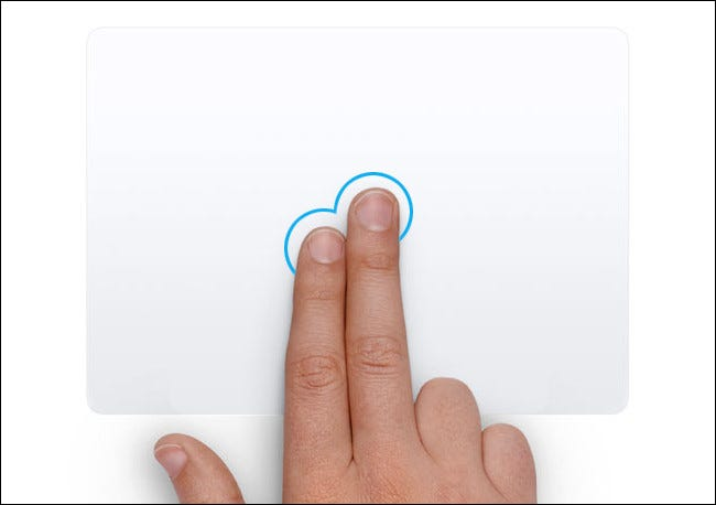 A hand right-clicking on a Mac touchpad.