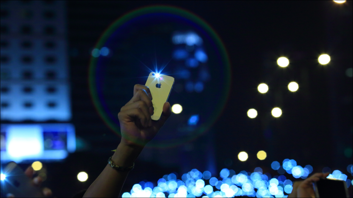 An iPhone held up by a protester in Hong Kong.