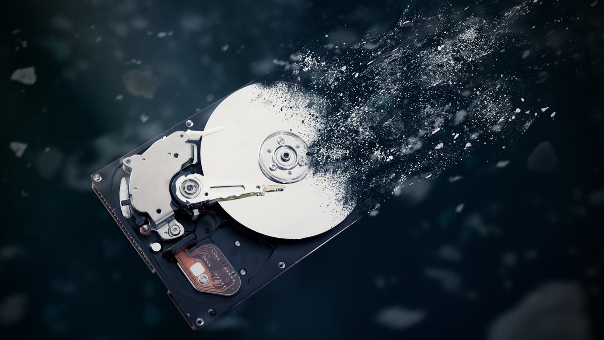 An illustration of a mechanical hard disk drive disintegrating.