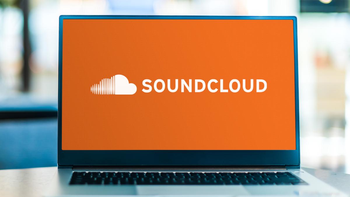 Open laptop showing the Soundcloud logo on an orange background