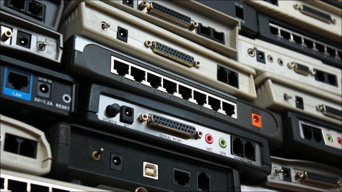 Closeup of a wall of old network routers and modems
