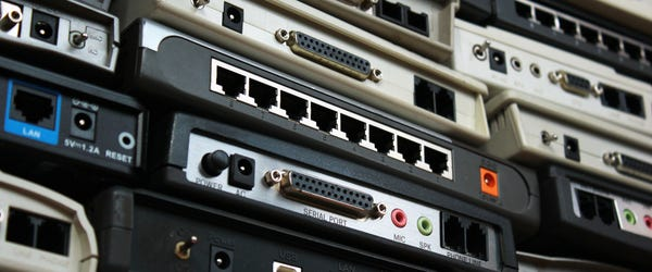 wall-of-old-network-routers.jpg?width=60
