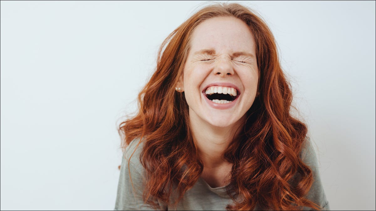 Woman laughing hysterically
