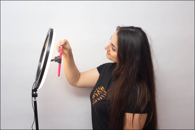 Woman taking a selfie with a ring light