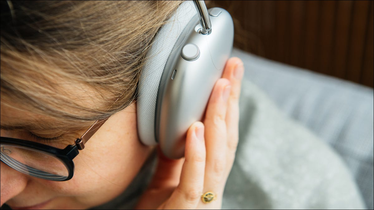 Closeup of headphone cup on woman's head