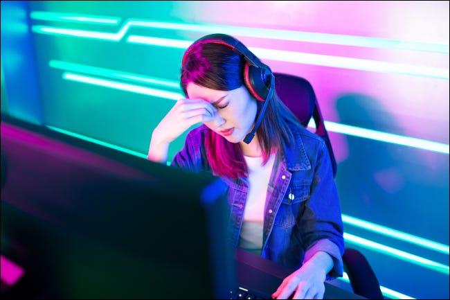 Young female esports gamer with fatigue
