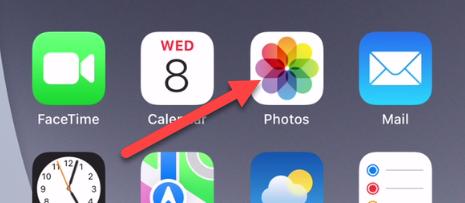 """Open the """"Photos"""" app."""