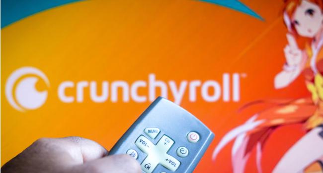 Person putting Crunchyroll on TV