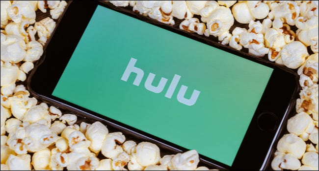 Hulu on a phone surrounded by popcorn