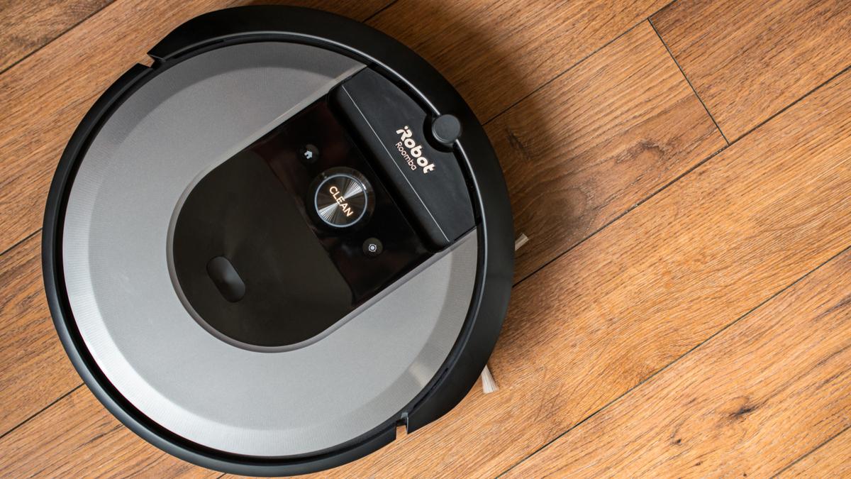 Roomba vacuuming wood panel floor