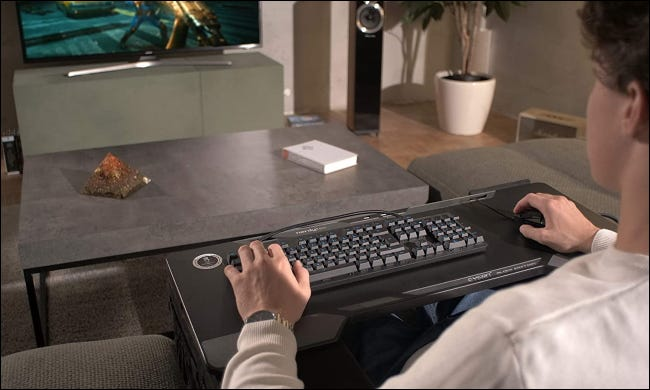 Person using Couchmaster cycon in living room