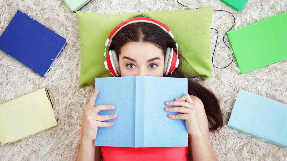 Girl listening to audiobook.