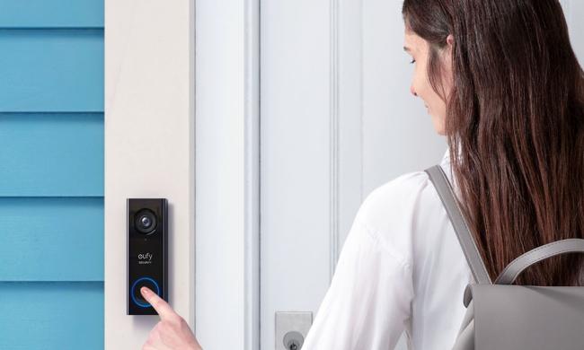 Person using eufy doorbell