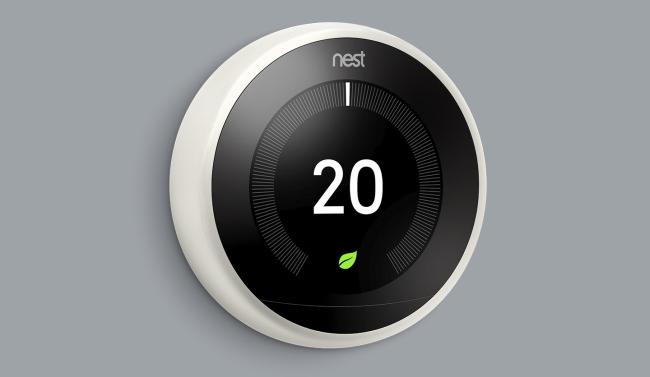 Google Nest Thermostat on grey wall