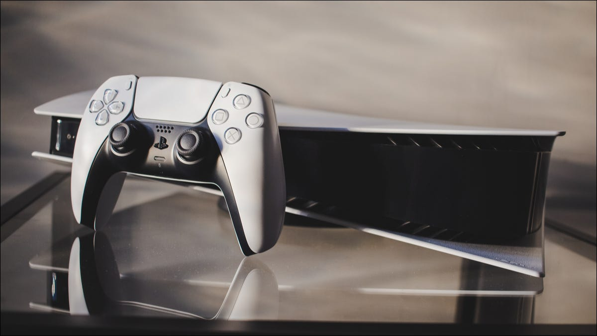 Playstation 5 and controller on glass table
