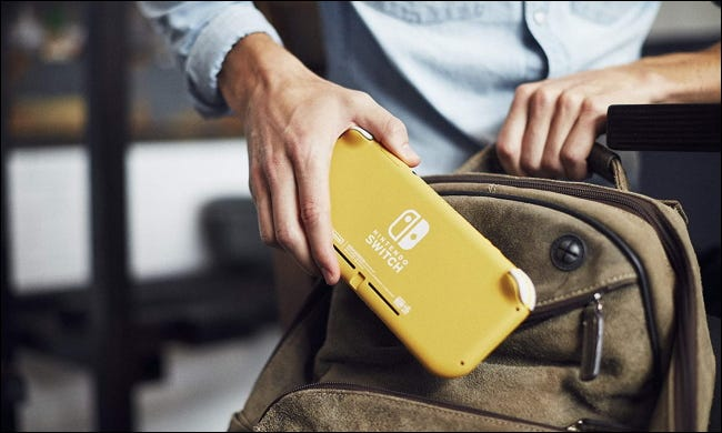 Person placing Switch Lite in backpack