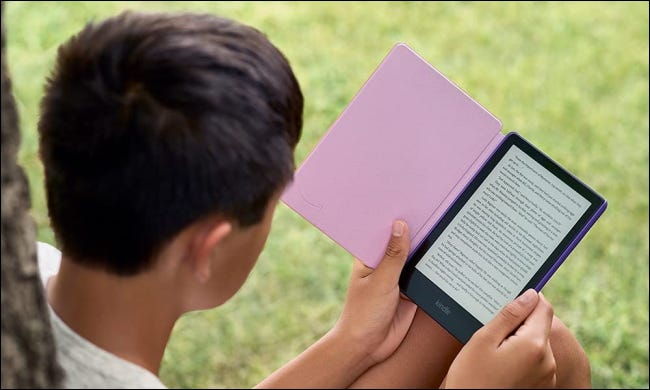 Child reading Kindle Paperwhite Kids