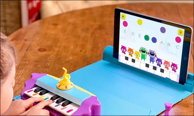 Child playing Plugo Tunes
