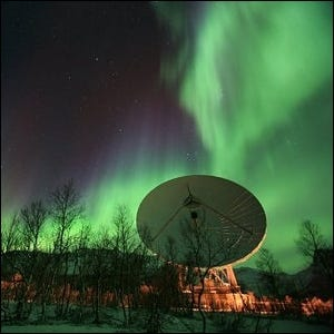 One of the EISCAT Radio Dishes seen against the northern lights