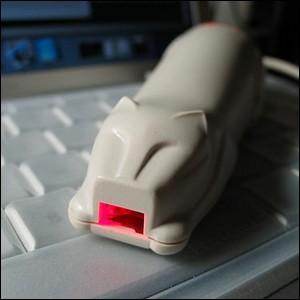 CueCat scanner resting on a keyboard