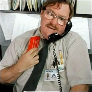 Milton, from the movie Office Space, holding his red stapler