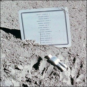 Photograph of the Fallen Astronaut installation, an aluminum figure on lunar soil