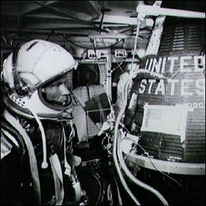 Gordon Cooper alongside the Faith-7 spacecraft, the capsule from the Mercury-Atlas 9 mission