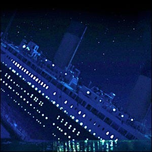 Scene showing the Titanic sinking against a backdrop of stars