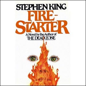 Cover of the Stephen King book Firestarter, featuring flames over the outline of a face