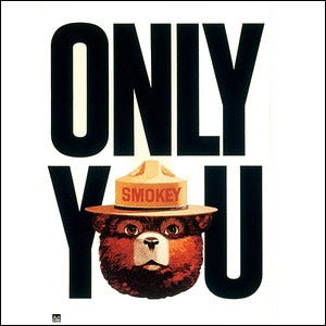 "Vintage Smokey the Bear fire prevention poster reading ""Only You"" where the O in You is Smokey's face"