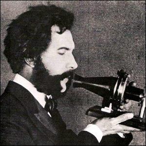 Alexander Graham Bell demonstrating an early telephone